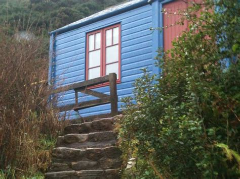 The Blue Cabin By The Sea by Blue Cabin By The Sea