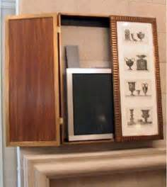 wall mounted cabinets adorned with photos or to hide