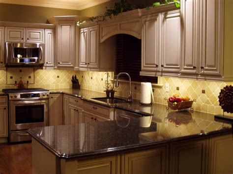 kitchen with white cabinets backsplash and bronze accents 4 great backsplash options for your kitchen the decorative touch ltd