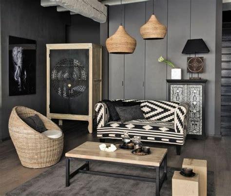 Nice Salon Mur Jaune  #2: Deco-salon-gris-peinture-murale-couleur-anthracite-canap%C3%A9-en-noir-et-blanc-fauteuil-en-rotin-jolies-suspensions-d%C3%A9co-africaine-e1476779264839.jpg