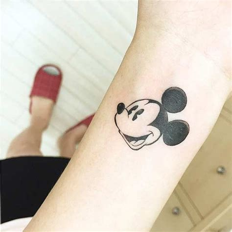 disney wrist tattoos 25 disney tattoos that are beyond vintage