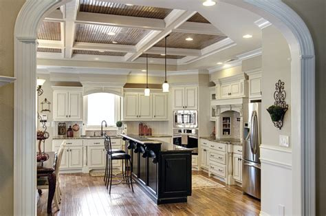 white kitchen cabinets with black island painted white cabinets with glazing and painted black