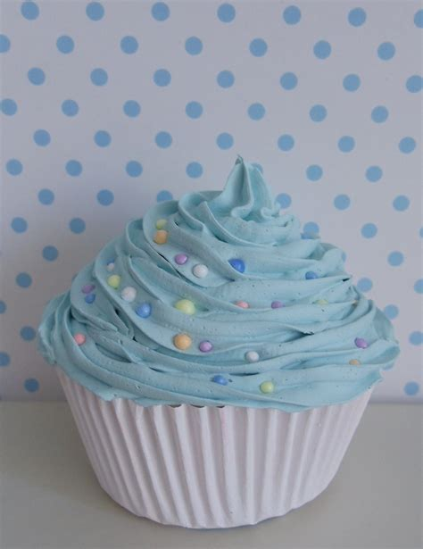 Sweet Cupcake With Light Blue Frosting With Colorful Candy For Cupcake Lights
