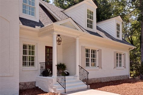 painted brick houses paint color is benjamin white dove the trim is also white dove and