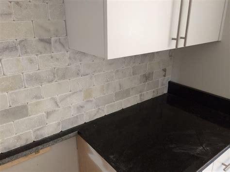 black pearl granite w white marble backsplash