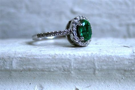 vintage engagement ring with emerald center onewed