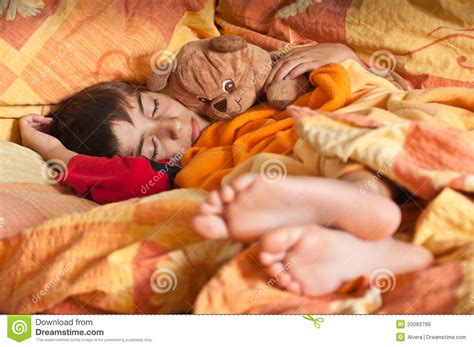 bed feet child sleep in bed bare feet royalty free stock images
