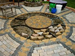 Patio Paver Blocks Wow Thats A Busy Garden Creating A Paver And Pebble Mosaic Patio