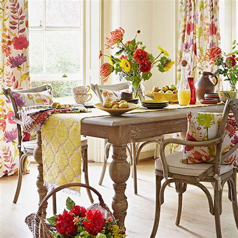 bright floral dining room with limed oak table dining