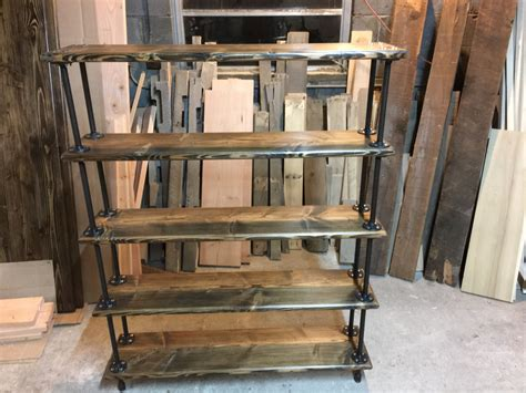 industrial pipe bookshelf by alexswoodworks on etsy