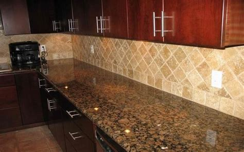 Baltic Brown Countertop by Baltic Brown Granite Countertops With Light Backsplash