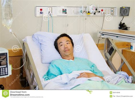 patient in hospital bed ill patient in hospital bed royalty free stock photos