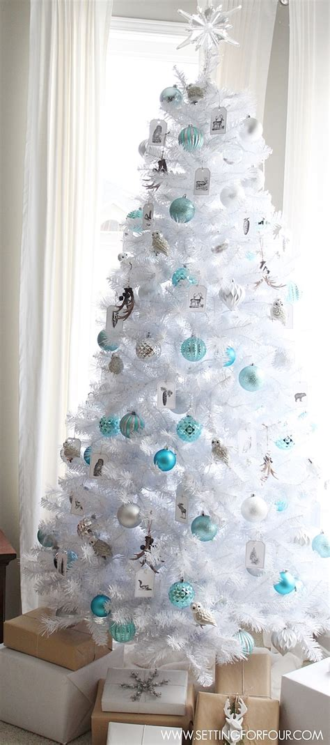 white decorations for a tree winter woodland glam white tree setting for four