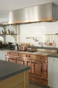 The copper stove and trim on the stainless steel hood compliment in