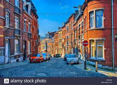 buying a house in belgium street with red brick houses in liege belgium benelux hdr stock photo royalty free