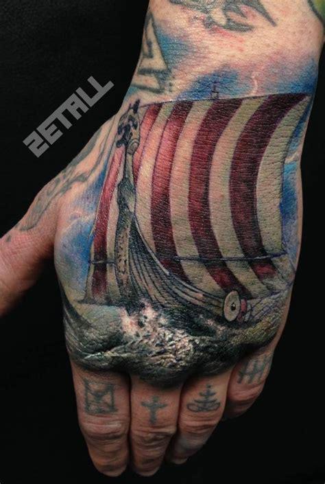 finger tattoo viking realistic style viking ship tattoo on the left hand