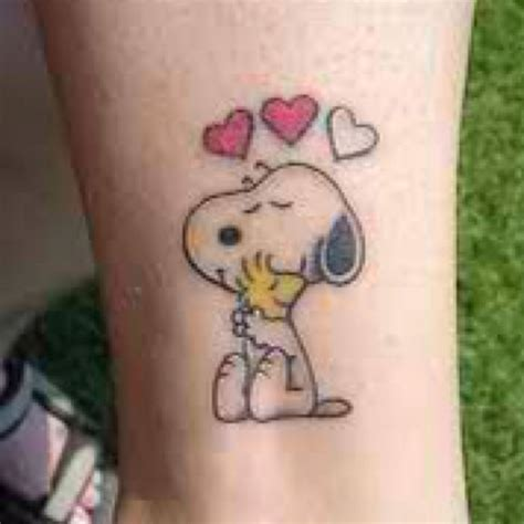 snoopy tattoo designs 15 must see snoopy pins tattoos
