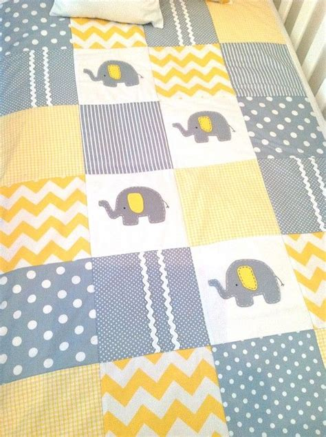 elephant pattern fabric uk elephant baby quilt and cushion cover in yellow and grey