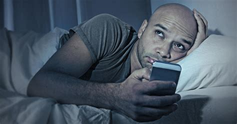 phone in bed doctors issue unusual warning for those using smartphones