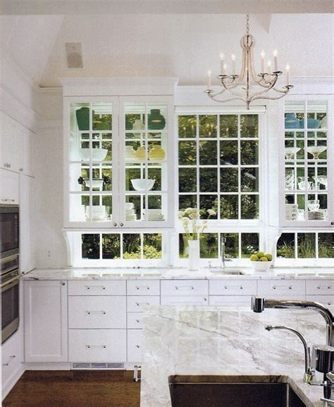 kitchen cabinets with windows behind shelves over windows kitchen