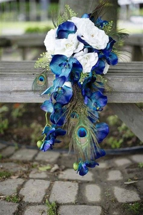 silk orchids peacock feathers and silk flowers on