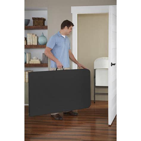 cosco 8 folding table cosco deluxe 8 ft black fold in half molded folding