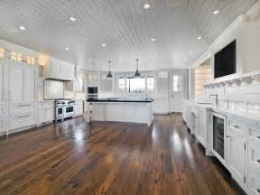reclaimed hardwood floor large remodel kitchen design painted with all white
