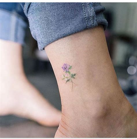 collection of 25 small lily flowers tattoo on arm