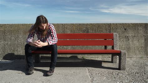 sad bench man sitting alone on bench sad worried and depressed 4k