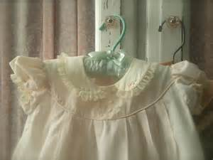 Vintage baby clothes have so many details and the hand embroidery