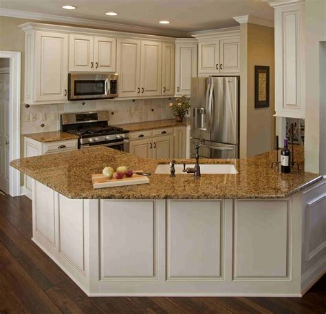 this white kitchen cabinets with brown granite countertops