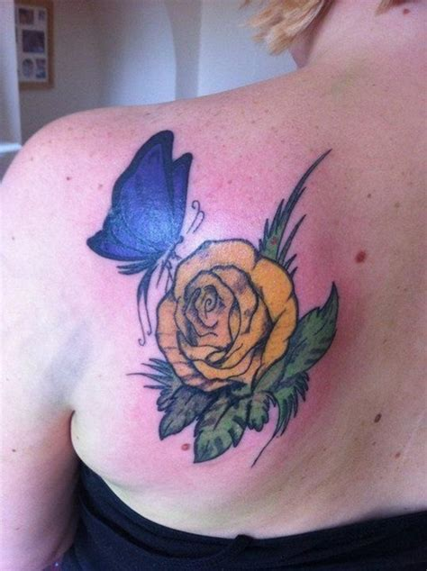 blue and yellow rose tattoo blue butterfly with yellow on back shoulder