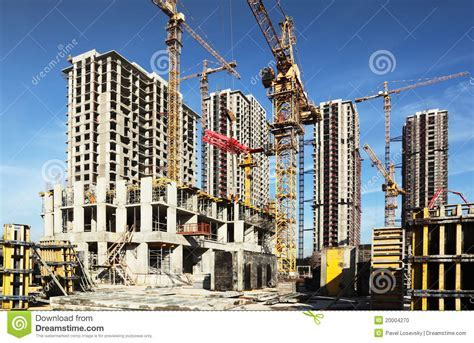 Many Tall Buildings Under Construction And Cranes Stock