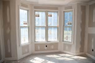 Bow Window Curtain Ideas window trim shows the baseboard and window trim