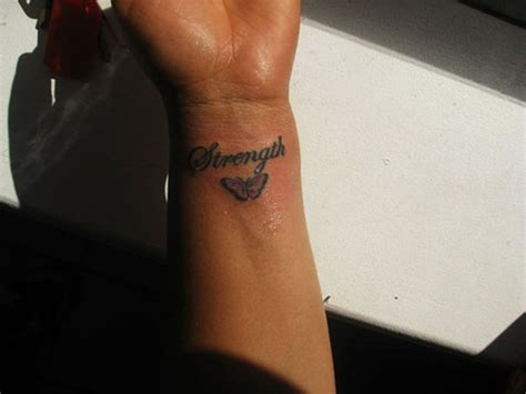strength wrist tattoo 82 awesome letter wrist tattoos design