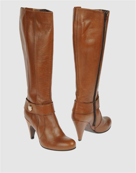 coccinelle high heeled boots in brown lyst