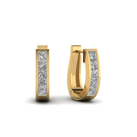 Huggie The huggie hoop earring in 14k yellow gold