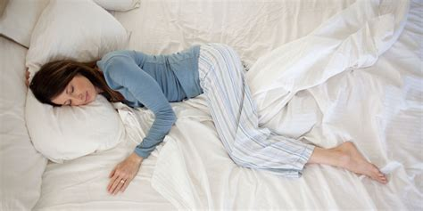 woman sleeping in bed 10 ways to sleep better every night