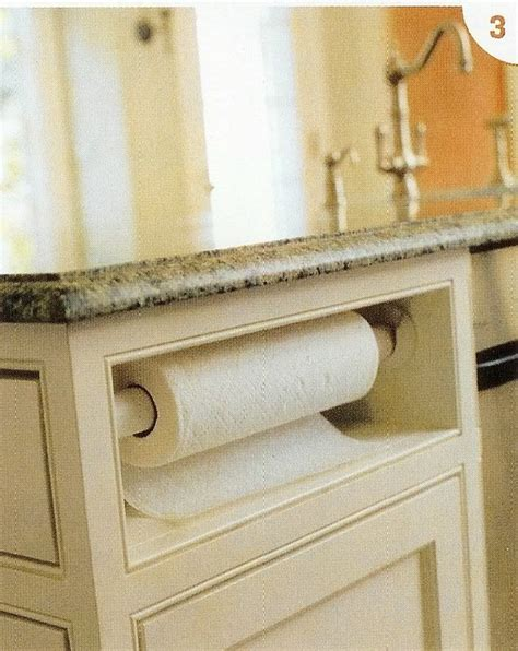 paper towel holder in cabinet paper towels in the island kitchens