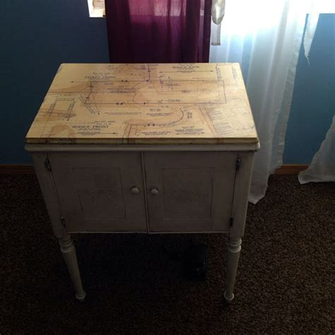 vintage singer sewing machine and cabinet painted in