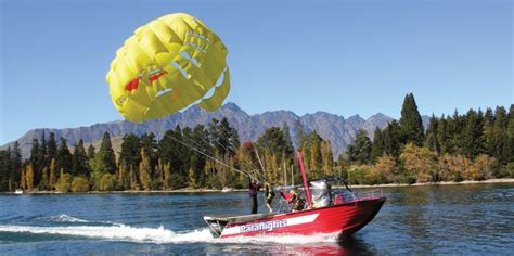 floating boat queenstown paraflights parasailing adventure activities tour