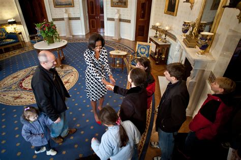 obama white house tour black and white wrap dress with red pumps incredible