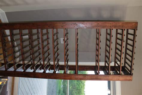 diy wine rack with glass shelf between3sisters