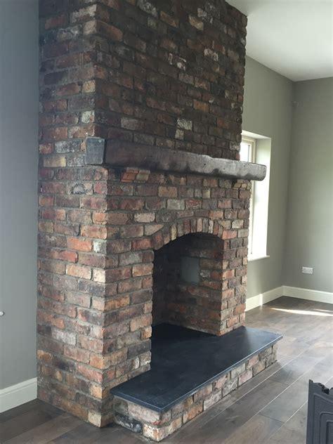 reclaimed brick feature fireplace  kilkenny limestone
