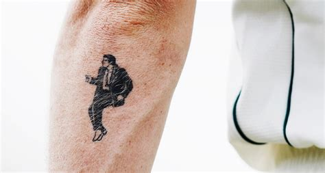 adam zampa has a tattoo of john travolta from pulp fiction
