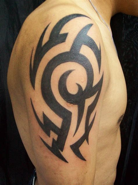 half tribal sleeve tattoos black tribal on right half sleeve