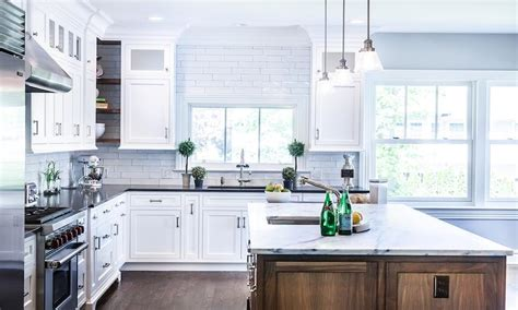 white and gray kitchen with robert porter pendants
