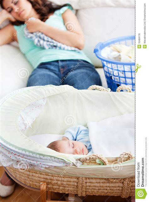 sleeping with baby on couch baby sleeping in his cradle with mother on couch royalty