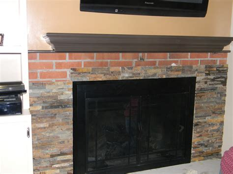 covering fireplace how to cover your brick fireplace with stone fireplaces