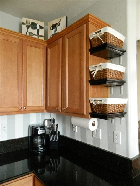 baskets on top of kitchen cabinets how to use the empty space on the side of kitchen cabinets